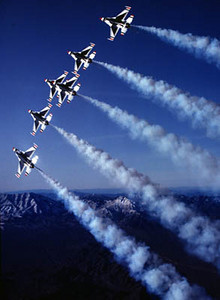 US Air Force Thunderbirds return to the air in their brand-new F-16 Fighting Falcon aircraft with the distinctive Thunderbird markings on the belly of the aircraft.