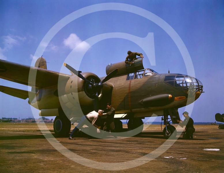 Sevicing a Douglas A-20 Havoc bomber, Langley Air Force Base, Virginia, July 1942.