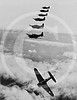 Douglas SBD Dauntless dive bombers, United States Navy. Dive bomber peeling off for attack 1940.