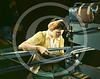 A woman riveting machine operator at the Douglas Aircraft Company plant joins sections of wing ribs to reinforce the inner wing assemblies of B-17F heavy bombers, Long Beach, California Oct 1942