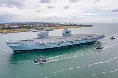 HMS Queen Elizabeth entering Portsmouth Harbour, UK