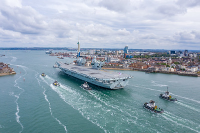 HMS Queen Elizabeth enters her home port of HMNB Portsmouth after a 3 week period of Sea Training for a brief stop to embark stores and ground crew ahead of her next phase of sea and aircraft trials.