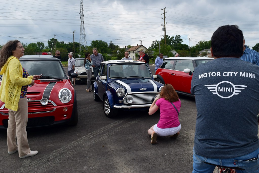 . MINI enthusiasts gather to kick off MINI on the Mack, where MINI motorers will rally in the Upper Peninsula on Saturday, Aug. 5 to try and break the Guinness World Record for the largest parade of MINI vehicles, on Friday, Aug. 4 at the M1 Concourse in Pontiac. (Photo by Natalie Broda - Digital First Media)