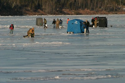 Fisherman and pop-up shelters on ice Lake Superior French River 390_9017