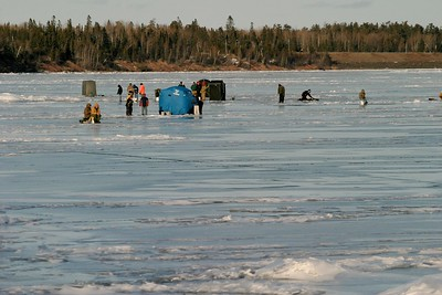 Fisherman and pop-up shelters on ice Lake Superior French River 390_9010