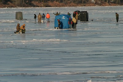 Fisherman and pop-up shelters on ice Lake Superior French River 390_9016
