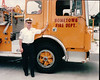 Dad next to Engine 468 the day of his promotion to CHIEF.