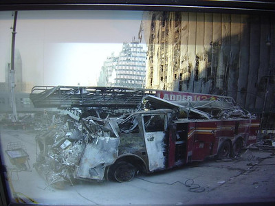 FDNY MUSEUM, PHOTOS FROM 9-11-01 IN THE MEMORIAL ROOM.  THIS IS A PHOTO OF LADDER CO. 113 DESTROYED.