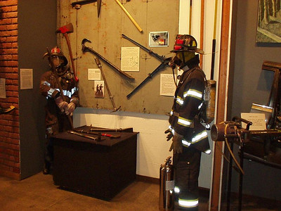 FDNY MUSEUM, DISPLAY OF TOOLS AND EQUIPMENT, SHOWING THE OLD AND THE NEW TURNOUT GEAR.