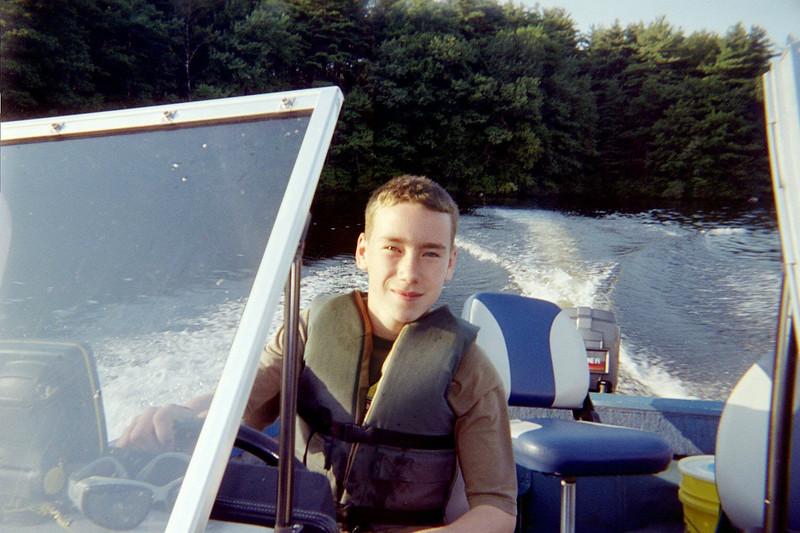 Greg driving boat