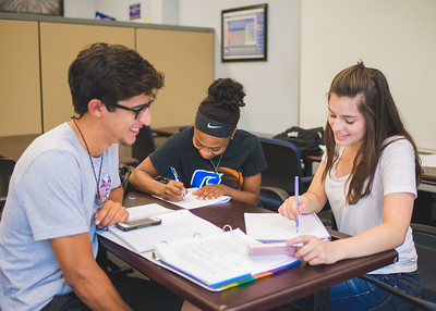 Nickolaus Barrera (left) Erin Willias and Mica Flores work together on their General Chemistry homework in the CASA study area.