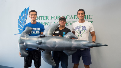 Nicholas Arenas (left), Roman Torres, and Tony Long pose with Hunter the Hammerhead in Center for Academic Student Achievement.  Learn about TAMU-CC's participation in Shark Week:  http://bit.ly/2uIUKYq