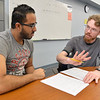 CASA tutor Devin O'Donnell(right) assists a student with his math assignment.