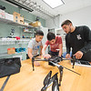 Vincent Nguyen(left) Daneils Gonzalez and Luis A Bonilla - Mechanical Engineers from TAMU-CC work on their UAS Project in the Unmanned Air Systems Lab.