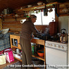 Jane washing dishes after eating some yummy blueberry pancakes while staying in Denali.