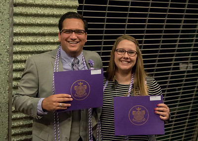 Students Justin Ruiz (Left) and Kimberlee Reed pose for a photo after being inducted into Sigma Theta Tau.