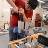 an-engineering-student-assembles-an-engine-compartment_13583307314_o
