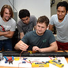engineering-students-work-on-the-wiring-set-up-for-an-unmanned-aerial-system-project_13896168843_o