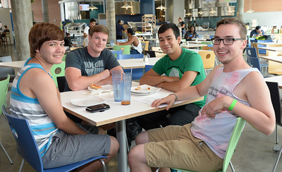 Students enjoying lunch at the new Dining Hall take a moment to smile for our cameras