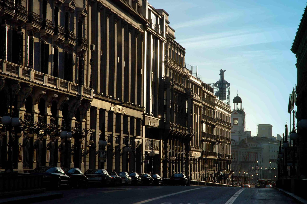Calle Alcala leads in a majestic curve of gradn old buildings to the central hub of Puerta del Sol