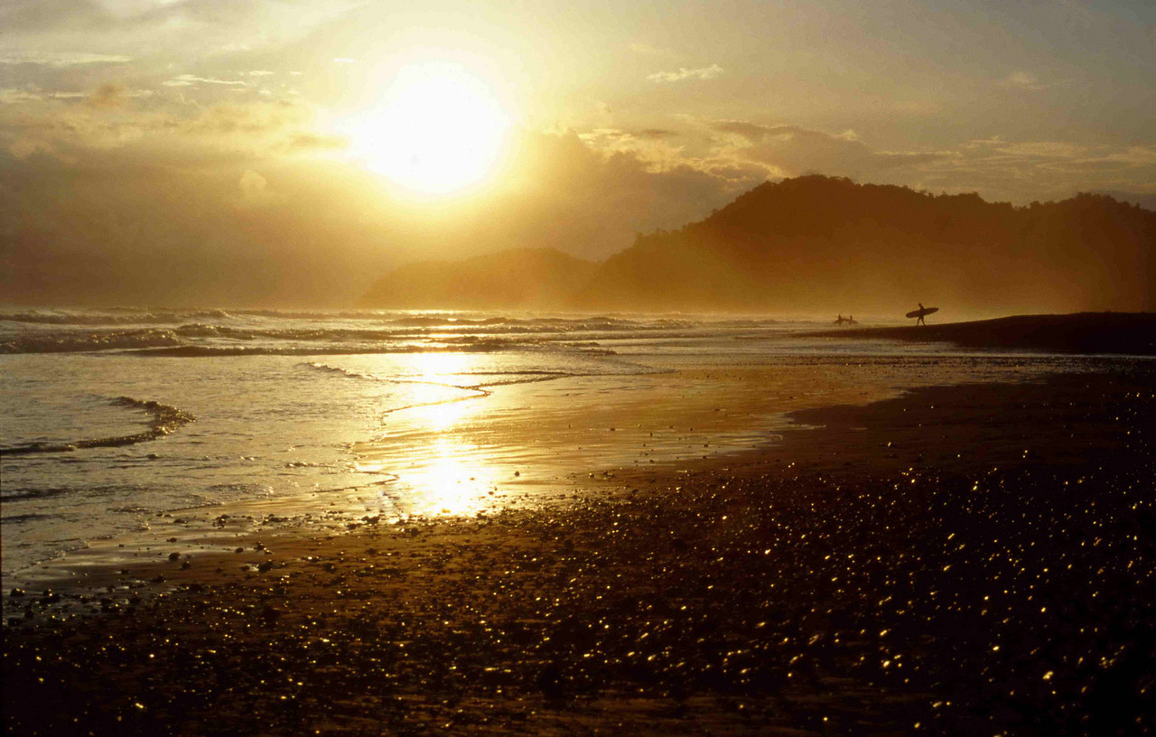 COSTA RICA -Surfer's check out the Pacific sunset session