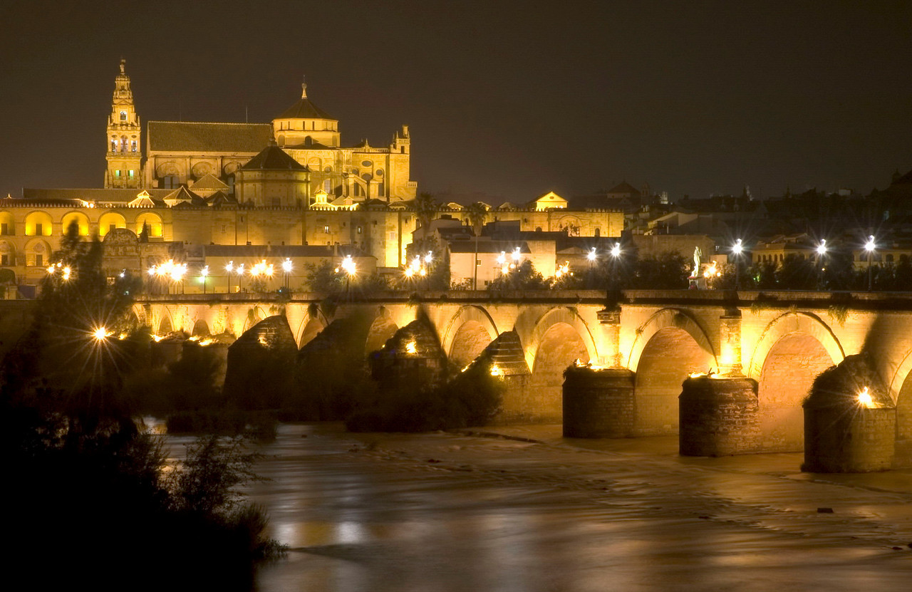 The Rio Guadalquivir flows under Cordoba's Puente Romano as it passes through what was once the greatest city in the Moorish Empire