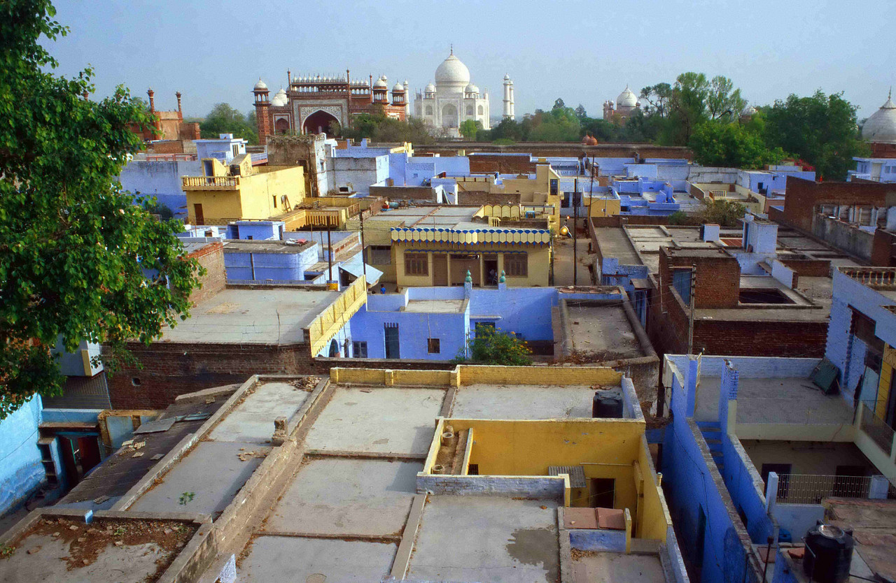 INDIA -The dome and towers of the Taj Mahal seem to float over the rooftops of Agra