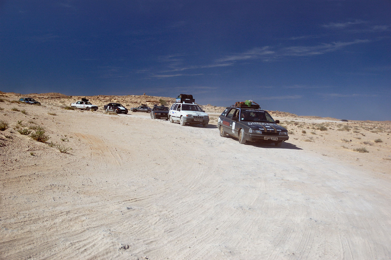 A convoys of competitors from the 2006 Plymouth-Banjul Rally  weave their way through a minefield in northern Mauritania.
