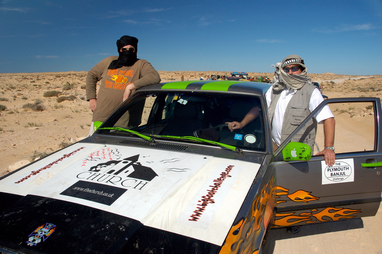 Bigfoot Challenge (competitor in the 2006 Plymouth-Banjul Rally) take a break in a minefield in northern Mauritania.