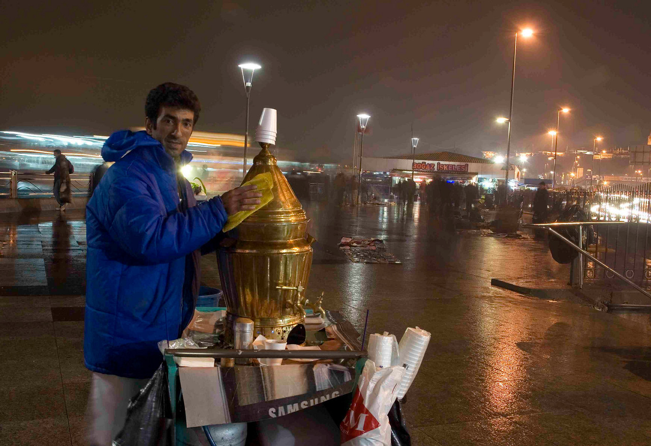 A street-vendor on the dockside at Eminonu (central Istanbul) sells 'salep.' This wrming winter drink - made from crushed tapioca roots and flavoured with cinnamon - is famed for its qualities as an aphrodisiac.