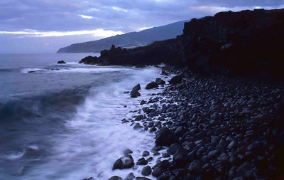 Atalntic waves crash onto a black sand beach on El Herro's noth shore.