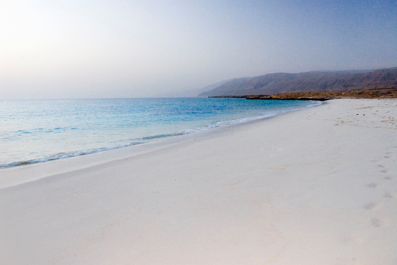 Remote 'White Beach' - at the foothills of the Eastern Hajars - makes the perfect oceanside camping site.