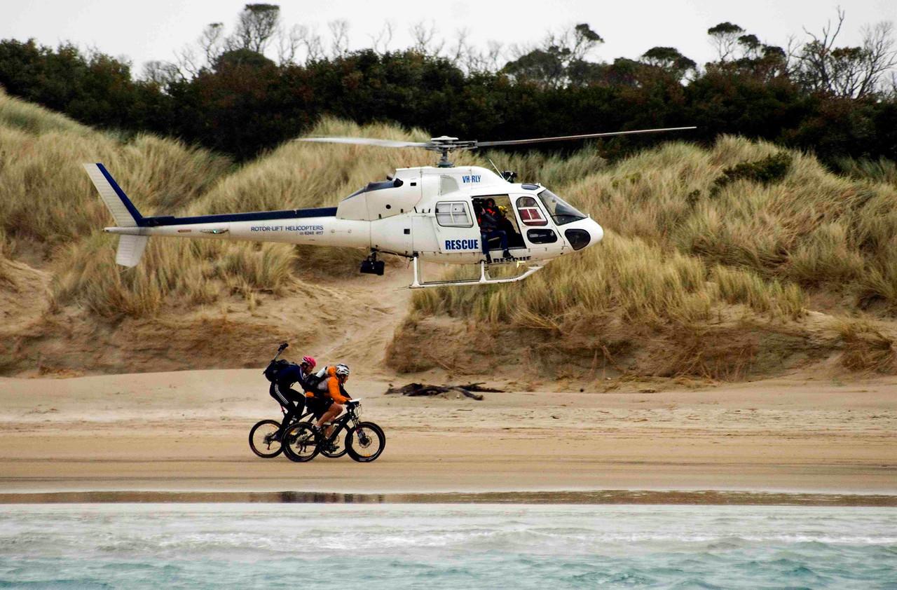 Mountainbikers on Ocean Beach, Western Tasmania, during the Mark Webber Challenge