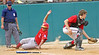 World Series home plate umpire looks on as New Jersey Braves Michael Rodrigez slides safely into home just as Indiana Rebels catcher Danny Rynerson gets the late throw in.