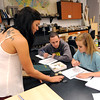 Geology students work on a lab identifying rocks