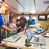 Families on tour of the Ocearch vessel receive information on the tags used on sharks.