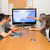Dr. Philippe Tissot(right) and his team, give a demonstation on the Weather on Wheels APP.