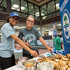 Dominique Casey (left) and Olivia Cohoon help themselves to a bagel provided y the Islander Alumni Association during Finals Week. in the Mary and Jeff bell Library.