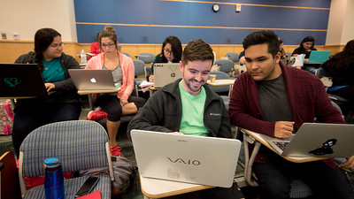 Colin Ratliff (center) and James Aceves take a moment to review notes before their class begins.