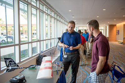 Hunter Morgan(left) with Lone Star UAS speaks to Colton Picazo on the Lancaster precision hawk model. Friday September 25, 2015 at the FAA public meeting in TAMU-CC.