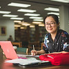 Student Xiaotian Tang studies for her US Politics class in the Mary and Jeff Bell Library.