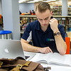 Student Wesely Bernhardt studies in the library