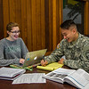 ROTC student Matthew Connell and Anissa Sardelich work on their studies together in the Faculty Center.
