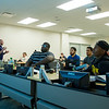 Students follow a powerpoint presentation as Professor Brian Warren lectures during a Sports Conditioning class.