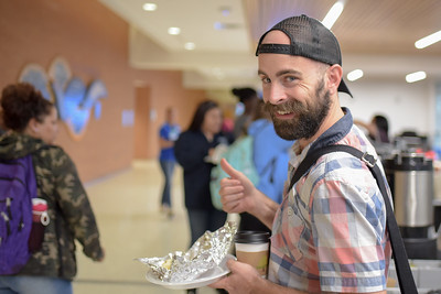Kyle Bauer picks up breakfast at the Tejas Lounge. During the Alumni Association's Taco Tuesday - Waves of Welcome event