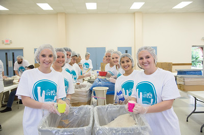 """Students smile for our cameras while performing volunteer work in the community for Student Volunteer Connection's """"Big Event""""."""