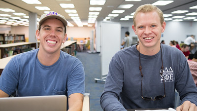 Michael Brode (left) and Wesley Jones hang out in the Mary and Jeff Bell Library.