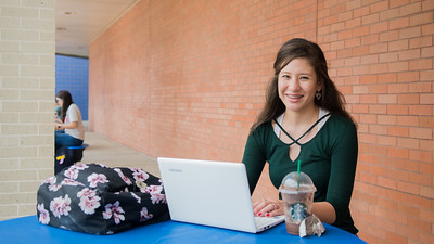 Student Meghan Garcia studies for her classes in the Center for Instruction Courtyard.