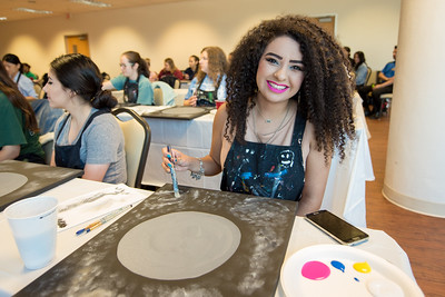 "Jaclyn Maldonado smiles while taking part in Project GRAD'S ""May the 4th Be With You"" Painting Party, one of many events being held on campus to help students relax during final exams."