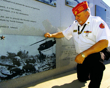 HENRY 11.10,11 ANCHOR 2 Marine Corps League of McDonough's Tom Oakes looks over images of Vietnam at The Veterans Wall Of Honor in McDonough. PHOTO BY JOE LIVINGSTON/STAFF